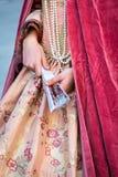 Beautiful woman´s costume of vibrant colors on venetian carniva. L 2014, Venice, Italy Royalty Free Stock Photo