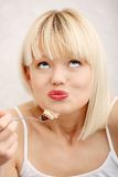 Beautiful woman's eating cake. Royalty Free Stock Photos