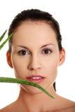 Beautiful woman's face and aloe vera. Royalty Free Stock Photo