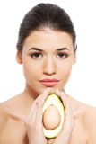 Beautiful woman's face with avocado. Royalty Free Stock Photo