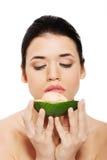 Beautiful woman's face with avocado. Stock Photos
