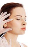 Beautiful woman's face is being prepareg to plastic surgery. Royalty Free Stock Photo