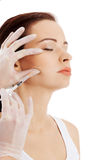 Beautiful woman's face is being prepareg to plastic surgery. Royalty Free Stock Images