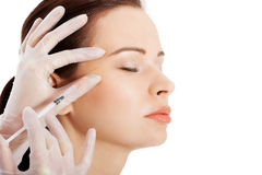 Beautiful woman's face is being prepareg to plastic surgery. Royalty Free Stock Photography