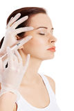 Beautiful woman's face is being prepareg to plastic surgery. Royalty Free Stock Photos
