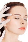 Beautiful woman's face is being prepareg to plastic surgery. Stock Photography