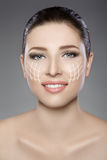 Beautiful woman`s face with blue eyes and clean fresh skin. Spa portrait. On grey background Stock Photo