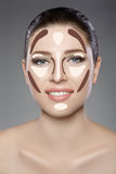 Beautiful woman`s face with blue eyes and clean fresh skin. Spa portrait. On grey background Royalty Free Stock Photos