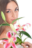 Beautiful woman's face with flowers Stock Photos