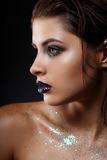 Beautiful woman`s face with gorgeous make-up close-up Stock Photo