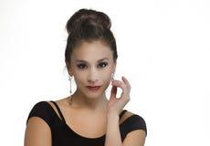 Beautiful woman's face hair in bun Stock Images