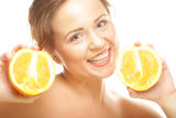 Beautiful woman's face with juicy orange Royalty Free Stock Photography