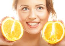 Beautiful woman's face with juicy orange Royalty Free Stock Photo