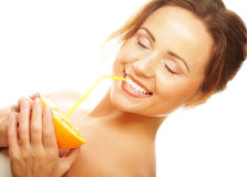Beautiful woman's face with juicy orange Royalty Free Stock Images