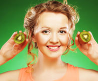 Beautiful woman`s face with kiwi Stock Photo