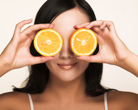 Beautiful woman`s face with orange. Closeup of a beautiful woman`s face with orange Royalty Free Stock Photo