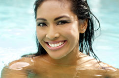 Beautiful woman's face with wet hair. Beautiful woman face with wet hair in swimming pool Royalty Free Stock Photography