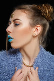 Beautiful woman 90s. Woman with hairstyle and makeup of 90s. Hipster fashion stylish girl. Turquoise lips. Beauty retouch Royalty Free Stock Image