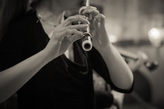 Beautiful woman's hand holding a Flute in black and white Stock Images
