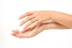 Beautiful woman's hands. On white background Stock Photo