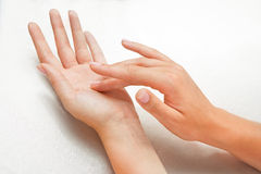 Beautiful woman's hands. With care cream Stock Photos