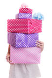 Beautiful woman's hands holding a colorful gift boxes with ribbon Royalty Free Stock Photo