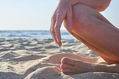 Beautiful woman`s legs on the beach background royalty free stock photography