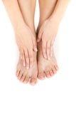 Beautiful woman's legs and hands on feet. stock image