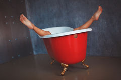 Beautiful woman's legs raised up from the bathtub Stock Photos