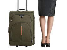 Beautiful woman's legs and travel suitcase Royalty Free Stock Photo