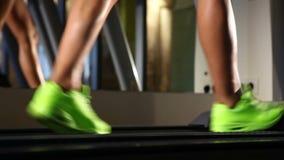 Beautiful woman's legs on treadmill stock footage