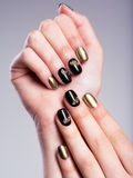 Beautiful woman's nails with creative manicure Stock Photos