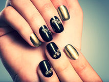 Beautiful woman's nails with creative manicure Royalty Free Stock Images