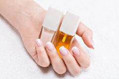 Beautiful woman's nails with french manicure Stock Photography