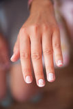 Beautiful woman`s nails. With beautiful french manicure royalty free stock photos