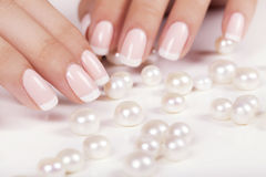 Beautiful woman's nails with french manicure. Stock Photography