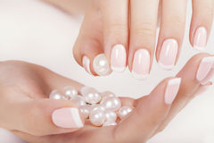 Beautiful woman's nails with french manicure. Stock Images