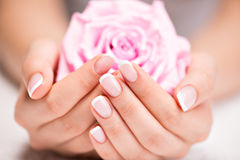 Beautiful woman's nails with french manicure  and rose Royalty Free Stock Photos