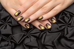 Beautiful woman's nails with nice stylish manicure stock image