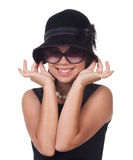 Beautiful woman's portrait. Portrait of a beautiful woman in retro hat and glasses Stock Photo