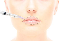 Woman's portrait with syringe Royalty Free Stock Photography