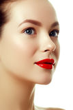 Beautiful woman`s purity face with bright red lip makeup. Close-up portrait of beautiful woman`s purity face with bright lip makeup. Beauty woman with clean Stock Images