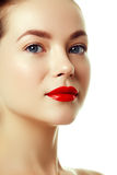 Beautiful woman`s purity face with bright red lip makeup. Close-up portrait of beautiful woman`s purity face with bright lip makeup. Beauty woman with clean Stock Image