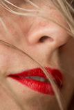 Beautiful woman's red lips and blonde hair Royalty Free Stock Photos