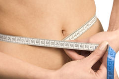 Beautiful woman's stomach with measure. royalty free stock photography