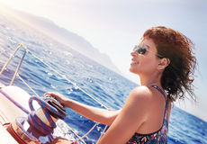 Beautiful woman on sailboat Royalty Free Stock Images