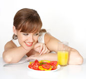 Beautiful woman with salad Stock Images