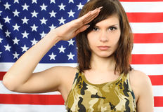 Beautiful woman salutes Stock Photos