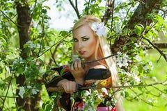 Beautiful woman samurai with katana sword Stock Photo