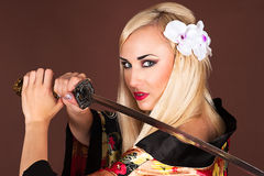 Beautiful woman with samurai sword Stock Images